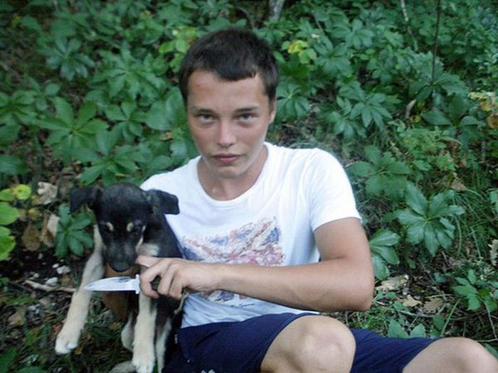 Russian neo-Nazi killing dog