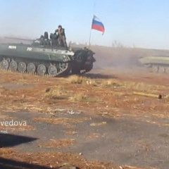 Russian terrorists firing Ukrainian troops from armored vehicle with Russian flag