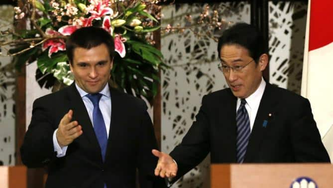 Ukraine's Foreign Minister Klimkin is escorted by Japan's Foreign Minister Kishida during their joint news conference at the foreign ministry's Iikura guest house in Tokyo