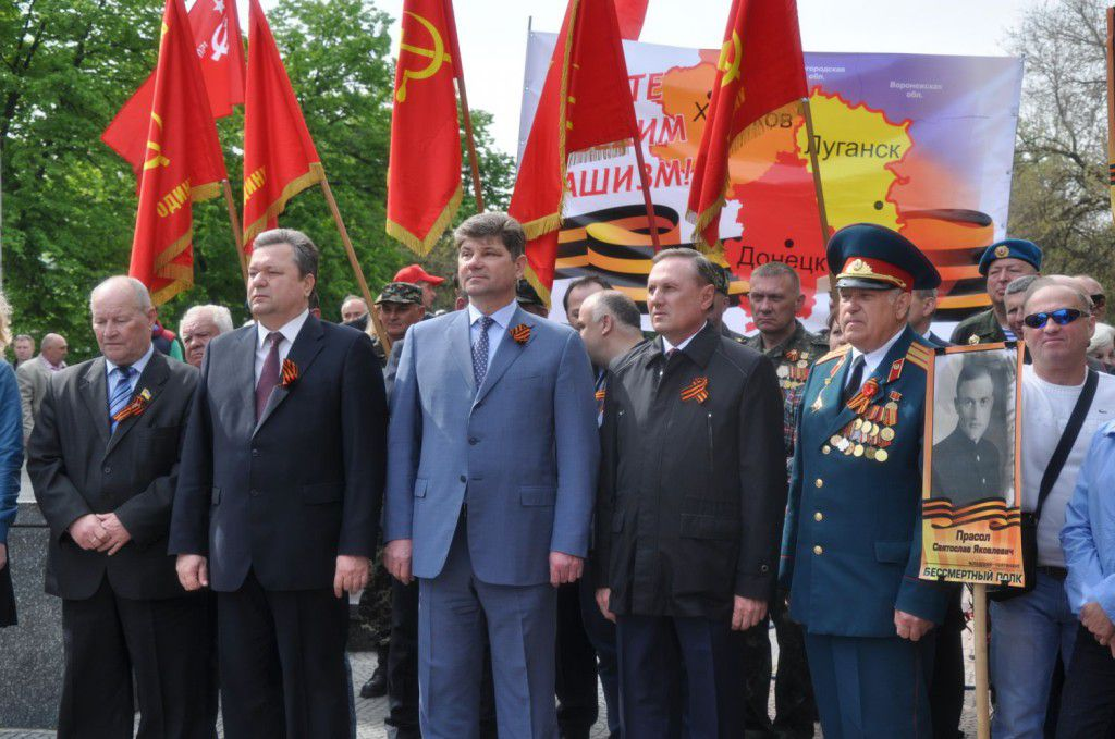 "Political rally 8.05.2014 in Luhansk which has been occupied by Russian troops from April 2014. From right to left: Spyrydon Kilinkarov  (Ukrainian Parliament Deputy from Communist Party), Valeriy Golenko ( Head of Luhansk region Council, member of Party of Regions), Sergiy Kravchenko (Mayor of Luhansk, member of Party of Regions) Oleksandr Yefremov (Ukrainian Parliament Deputy from Party of Regions). They all now live in Kyiv. The criminal case opened against Yefremov for separatism is closed ""because the lack of evidences"""